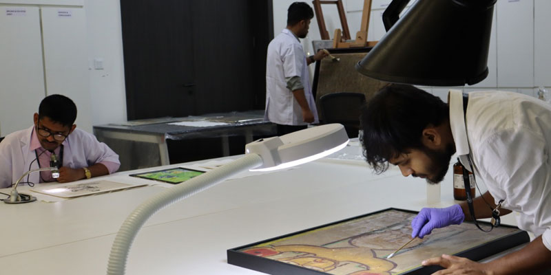 Conservators at work at KIAC, Kolkata