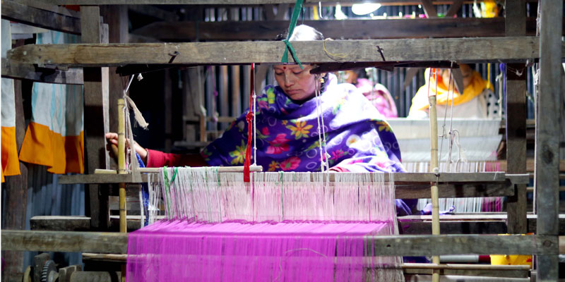 A beneficiary working on a loom powered by solar energy in the project area of SEVA in Manipur