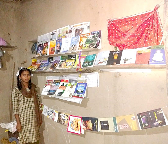 Nhina with her collection of books