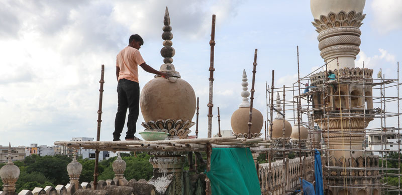 Re-plastering one of the minarets of The Great Mosque with lime putty