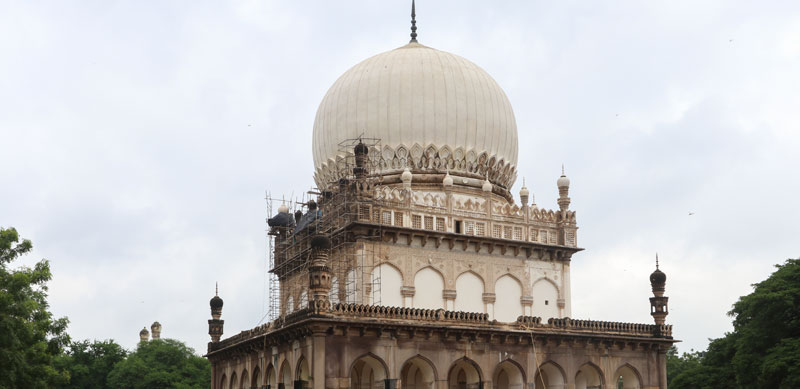 Exterior façade of the Tomb of Abdullah Qutb Shah with scaffolding in place