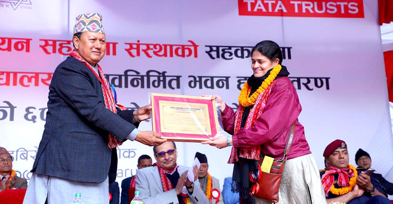 Amrita Patwardhan, Zonal Head, North, Tata Trusts, receiving an appreciation letter from Mohan Bahadur Basnet, former Minister for Information and Communications, Government of Nepal