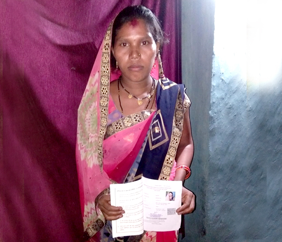 Madhuri Bai Baghel with her newly-acquired ration card
