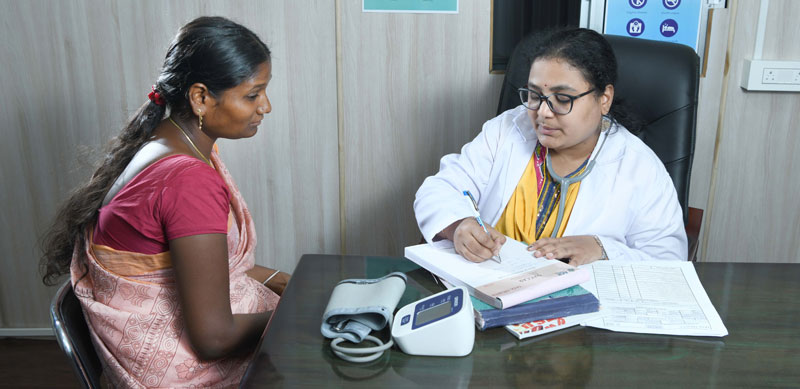 A doctor with her patient during a consultation hour