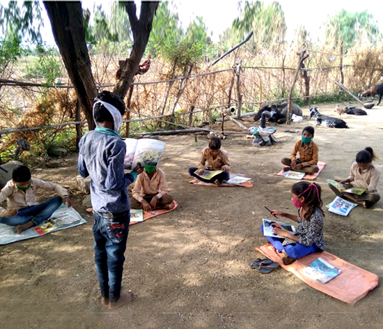 Children learning in an open space