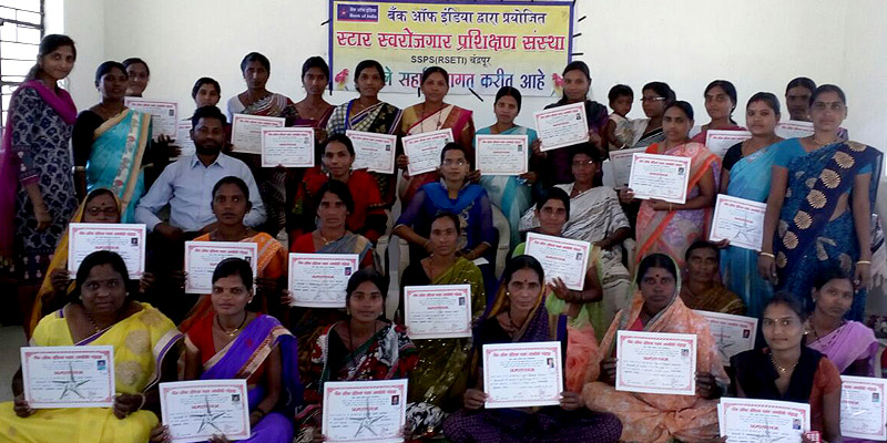 Participants showing their certificates after completing a vocational training