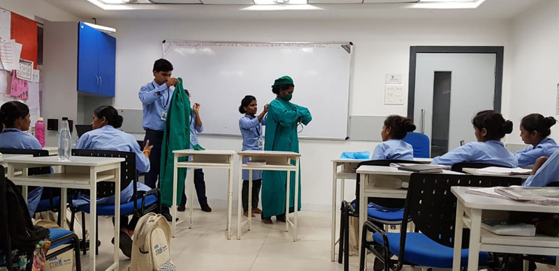 Students learning the skills of a General Duty Assistant at Tata STRIVE Skill Development Centre