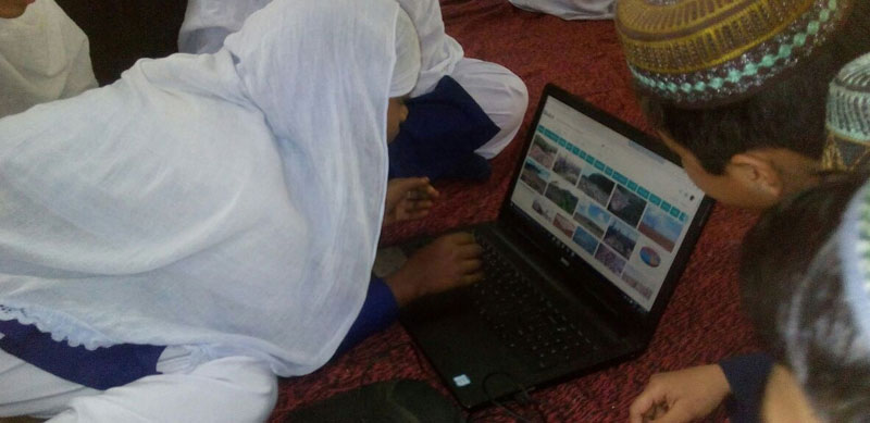 Students of a government madarsa in West Bengal working on an ITE project