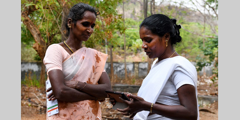 An ANM recording the screened parameters of a woman, during her village visit