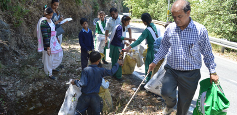 Students from the local school participating in a clean-up drive