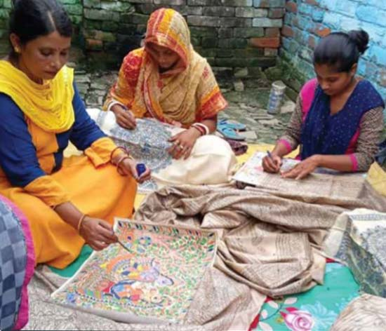 Ragini teaching Madhubani painting art to other women in her village