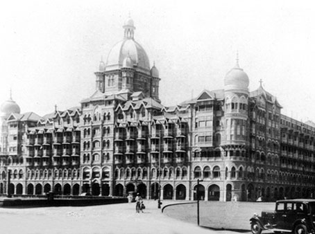 The Taj Mahal Hotel rises on the sea front and adds to the grace of the city of Bombay