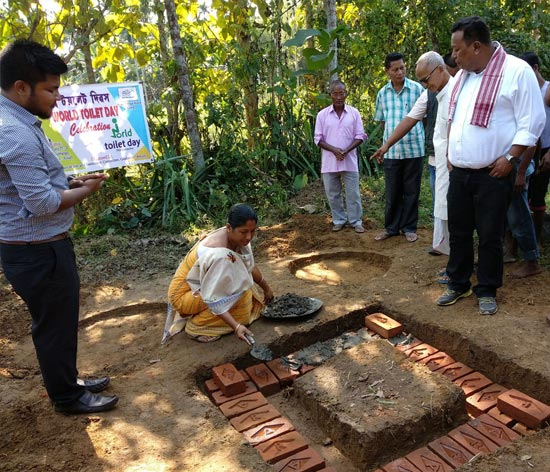 Dudhnoi gram panchayat president performing shramdaan (voluntary labour) to construct a toilet