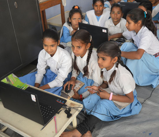 Children making the most of technology and learning from visual content using a laptop