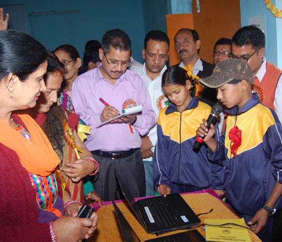 A tech-savvy student of a Tehri Garhwal school confidently explaining his multimedia project